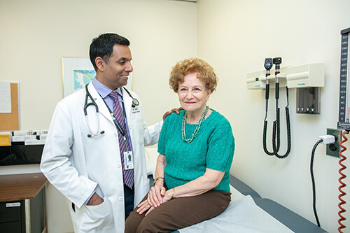 image of Dr. Samir Sinha with patient